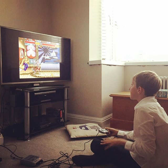 He's been obsessed with Street Fighter since the SNES mini arrived. I was exactly the same at almost exactly the same age. He's still@not managed to take a single fight off me though