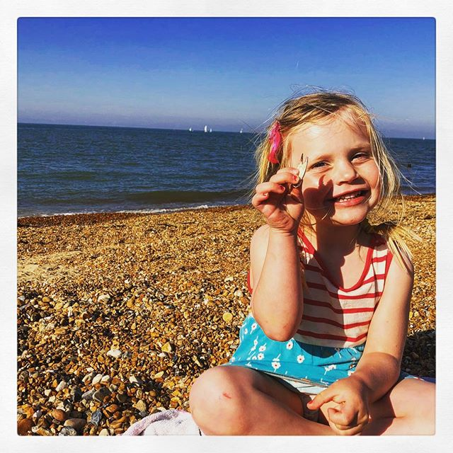 Pleased as punch at finding herself a claw on the beach today